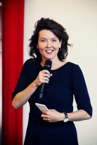 Kim Coppes aan het werk als dagvoorzitter
